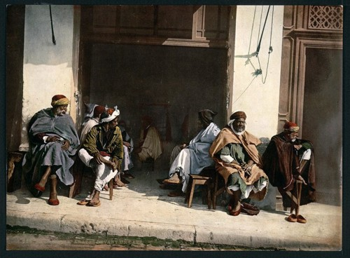 [Arabs before a cafe, Algiers, Algeria]